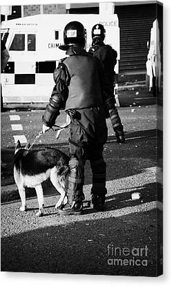 Psni Dog Handler In Riot Gear With Dog On Crumlin Road At Ardoyne Shops Belfast 12th July Canvas Print