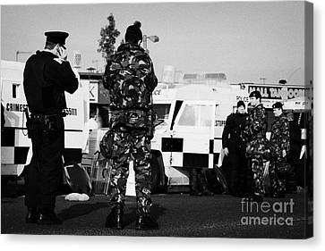Terrorist Canvas Print - Psni Officers And British Army Soldiers At Psni Landrovers On Crumlin Road At Ardoyne Shops Belfast  by Joe Fox