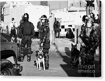 Psni Riot Officers And Dog Handler And Armed Soldiers On Crumlin Road At Ardoyne Shops Belfast 12th  Canvas Print