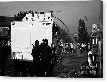 Psni Riot Officers Behind Water Canon During Rioting On Crumlin Road At Ardoyne Canvas Print