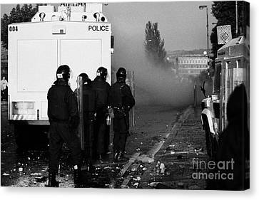 Psni Riot Officers Behind Water Canon During Rioting On Crumlin Road At Ardoyne Shops Belfast 12th J Canvas Print