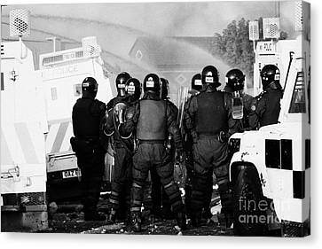 Psni Riot Officers Watch Rioting And Water Canon On Crumlin Road At Ardoyne Shops Belfast 12th July Canvas Print