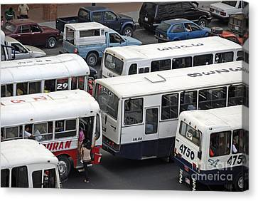 Public Buses In Traffic Jam Canvas Print by Sami Sarkis