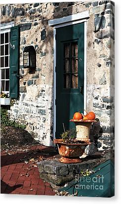 Pumpkins By The Door Canvas Print by John Rizzuto