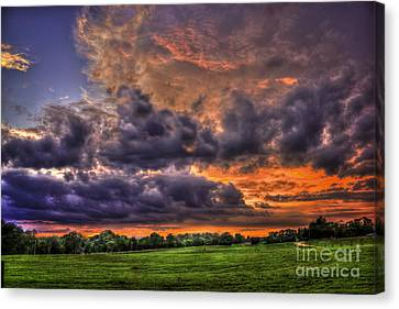 Purple Haze Clouds At Sunset Over The Hayfield Canvas Print by Reid Callaway