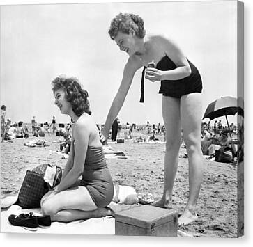 Sun Tan Canvas Print - Putting On Sun Tan Lotion by Underwood Archives