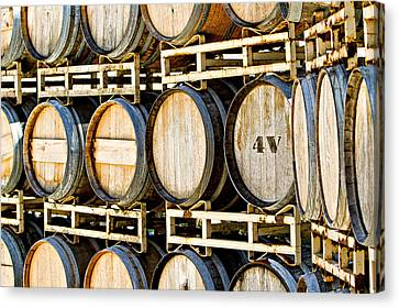 Rack Of Old Oak Wine Barrels Canvas Print by Susan Schmitz
