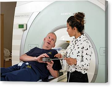 Radiographer Explaining Mri Procedure Canvas Print by John Cairns Photography/oxford University Images