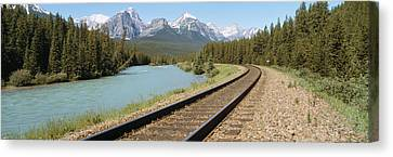 Railroad Tracks Bow River Alberta Canada Canvas Print by Panoramic Images