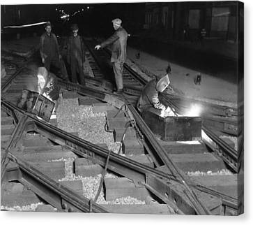 Medium Group Of People Canvas Print - Railroad Workers Welding Track by Underwood Archives