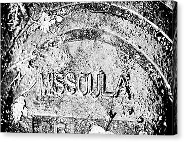 Rain Covered Manhole Cover In Missoula Canvas Print by James White