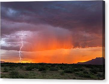 Rain Storm At Sunset Canvas Print by Roger Hill