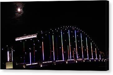Rainbow Bridge And Super Moon Canvas Print by Dan Sproul