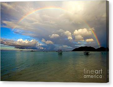 Rainbow In The Seychelles Canvas Print by Tim Holt