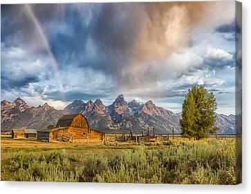 Rainbow On Moulton Barn - Horizontal - Grand Teton National Park Canvas Print by Andres Leon