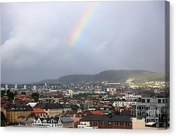 Rainbow Over Oslo Canvas Print by Carol Groenen