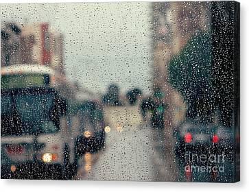 Rainy City Street Canvas Print by Kim Fearheiley