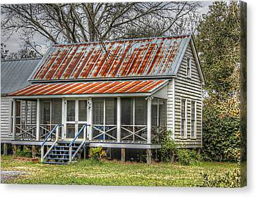 Raised Cottage With Tin Roof Canvas Print by Lynn Jordan