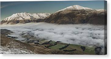 Rakaia River Valley Filled With Fog Canvas Print by Colin Monteath