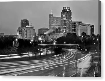 Canvas Print featuring the photograph Raleigh Skyline At Dusk Evening Black And White Bw Evening Panorama North Carolina Nc by Jon Holiday