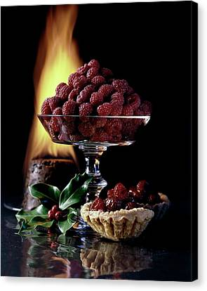 Raspberries In A Glass Serving Dish With Tarts Canvas Print by  Fotiades