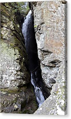 Raven Cliff Falls Canvas Print by Susan Leggett