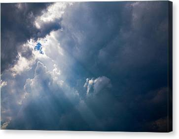 Rays Of Sunshine Through Dark Clouds Canvas Print by Natalie Kinnear