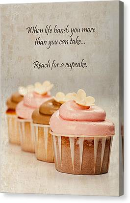 Reach For A Cupcake Canvas Print by Susan Schmitz