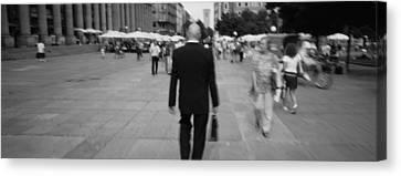 Rear View Of A Businessman Walking Canvas Print
