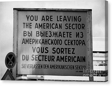 reconstruction of the you are leaving the american sector sign at checkpoint charlie Berlin Germany Canvas Print