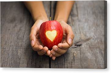 Red Apple With Engraved Heart Canvas Print by Aged Pixel