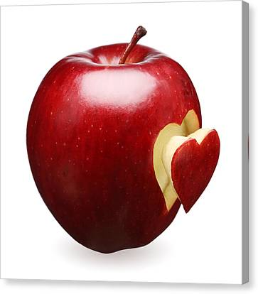 Red Apple With Heart Canvas Print by Johan Swanepoel