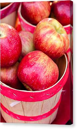 Red Apples In Baskets At Farmers Market Canvas Print by Teri Virbickis