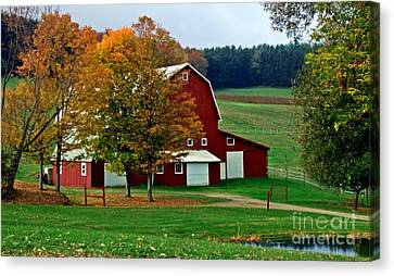 Red Barn In Autumn Canvas Print by Christian Mattison