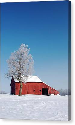 Red Barn In Snow Canvas Print by Jim West