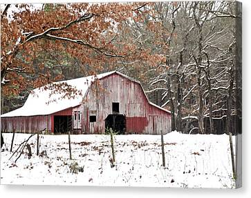 Red Barn In Snow Canvas Print by Robert Camp