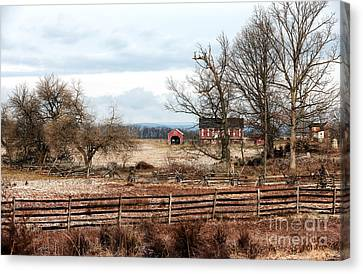 Red Barn In The Field Canvas Print by John Rizzuto