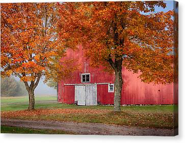 Canvas Print featuring the photograph Red Barn With White Barn Door by Jeff Folger
