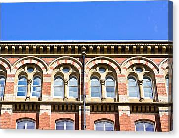 Red Brick Building  Canvas Print by Tom Gowanlock