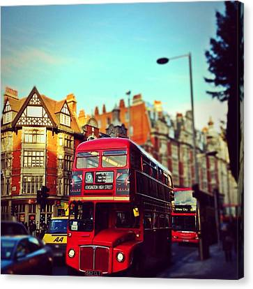 Red Bus On High Street Kensington Canvas Print by Maeve O Connell