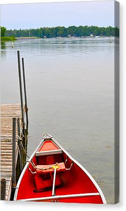 Red Canoe Canvas Print by Jeremy Evensen
