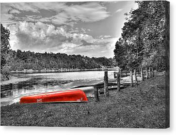 Red Canoe Canvas Print by Todd Hostetter