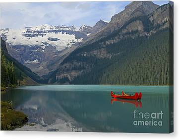 Red Canoes On Lake Louise Canvas Print by Teresa Zieba