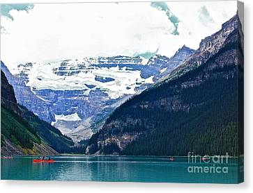 Canvas Print featuring the photograph Red Canoes Turquoise Water by Linda Bianic