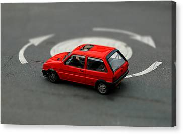 Red Car In Roundabout. Canvas Print by Rob Huntley