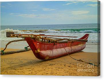 Red Catamaran At The Hikkaduwa Beach Canvas Print by Regina Koch