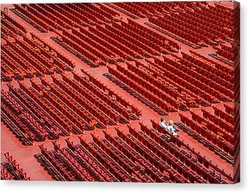 Red Chairs Canvas Print by Dobromir Dobrinov