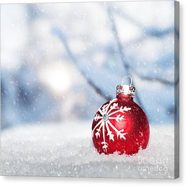 Merry -go- Round Canvas Print - Red Christmas Ball On Snow. by Michal Bednarek