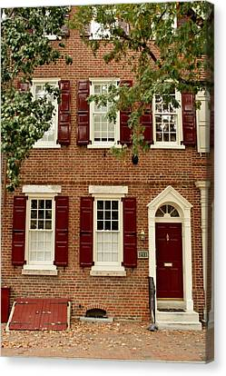 Red Door And Shutters Canvas Print by Christopher Woods