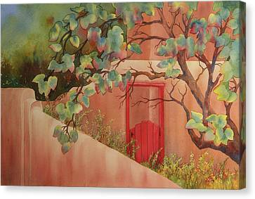 Red Door In Adobe Wall Canvas Print